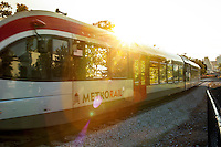 The Capital Metro MetroRail train pulls into the Plaza Saltillo Capital Metro Rail commuter rail station in East Austin on a sunny summer's day.