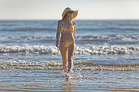 Natasha Jenkins enjoys the unusually warm weather on the beach in Swansea Bay, Wales, UK. Monday 25 February 2019