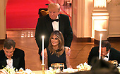 United States President Donald J. Trump shows First Lady Melania Trump to her seat as they attend a White House Historical Association dinner at the White House, May 15, 2019, in Washington, DC. The organization's goal is to promote the public's understanding, appreciation and enjoyment of the White House. <br /> Credit: Mike Theiler / Pool via CNP