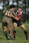 A. Ah Sui gets taken in the tackle of V. Pihigia. Counties Manukau Premier 2 Championship game between Bombay and Papakura played at Bombay on May 13th, 2006. Papakura won 8 - 7.