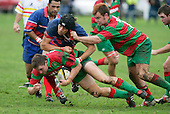 Waiuku flanker T. Parry is taken to ground by his opposite, S. Te Tamaki. D.Olson is close at hand to lend asisstance. Counties Manukau Premier Club Rugby, Ardmore Marist vs Waiuku played at Bruce Pulman Park, Papakura on the 29th of April 2006. Ardmore Marist won 10 - 9.