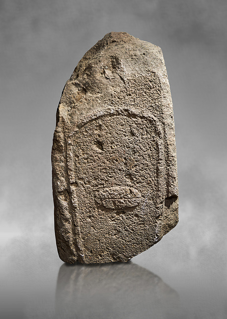 Late European Neolithic prehistoric Menhir standing stone with carvings on its face side. Excavated from Amassed VII, Allai.  Menhir Museum, Museo della Statuaria Prehistorica in Sardegna, Museum of Prehoistoric Sardinian Statues, Palazzo Aymerich, Laconi, Sardinia, Italy