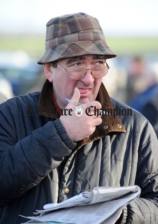 Kildysart's Joe Hogan studying form at the Clare Hunt annual Point to Point at Bellharbour. Photograph by John Kelly.