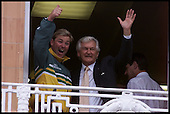 A jubilant Shane Warnewaves to the crowd at Lords, with former Prime Minister Bob Hawke..... 1999 Cricket World Cup, Pakistan V Australia at Lords.... Pic Donald MacLeod