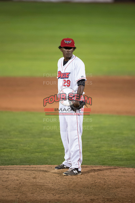 Orem Owlz relief pitcher Adalberto Pena (29) looks in for the sign during a Pioneer League game against the Ogden Raptors at Home of the OWLZ on August 24, 2018 in Orem, Utah. The Ogden Raptors defeated the Orem Owlz by a score of 13-5. (Zachary Lucy/Four Seam Images)