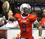 SIOUX FALLS, SD - JUNE 23:  James Terry #9 from the Sioux Falls Storm holds the ball up in celebrating a touchdown against the Lee Valley Steelhawks in the first quarter of their first round playoff game Saturday night at the Sioux Falls Arena. (Photo by Dave Eggen/Inertia)
