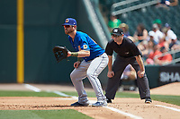 Durham Bulls first baseman Mac James (28) on defense as first base umpire Randy Rosenberg looks on during the game against the Charlotte Knights at BB&T BallPark on May 27, 2019 in Charlotte, North Carolina. The Bulls defeated the Knights 10-0. (Brian Westerholt/Four Seam Images)