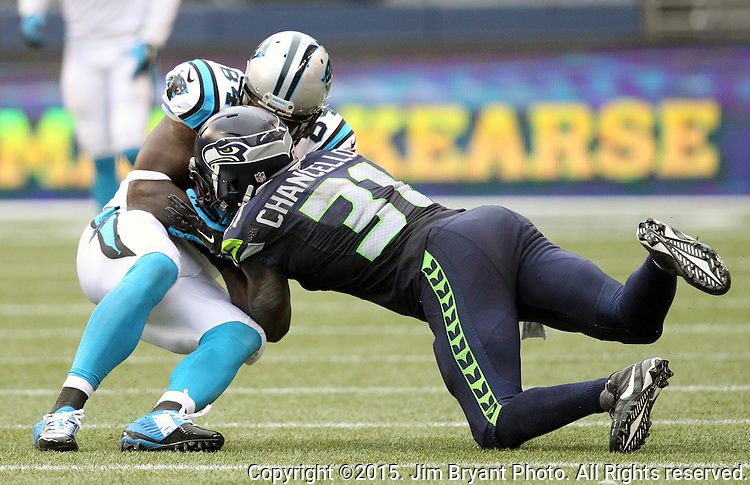 Carolina Panthers  tight end Ed Dickson (84) is tackled by Seattle Seahawks strong safety Kam Chancellor (31) at CenturyLink Field in Seattle on October 18, 2015. The Panthers came from behind with 32 seconds remaining in the 4th Quarter to beat the Seahawks 27-23.  ©2015 Jim Bryant Photography. All Rights Reserved.
