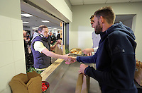 Pictured: Fernando Llorente and Angel Rangel handing out goodie bags Tuesday 29 November 2016<br />Re: Soup kitchen for homeless people organised by Swansea City FC and Woolwich at the Liberty Stadium, Wales, UK