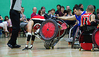 15 AUG 2011 - LEEDS, GBR - Great Britain's Alan Ash helps Mike Whitehead as the Canadian topples over during the wheelchair rugby exhibition match between Great Britain and Canada .(PHOTO (C) NIGEL FARROW)