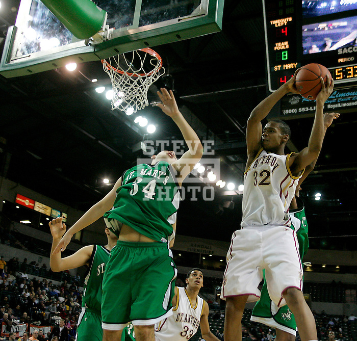 St. Anthony basketball player AJ Rogers (32) grabs a rebound during a game against St. Mary's as part of the Primetime Shootout at the Sovereign Bank Arena in Trenton, New Jersey on February 10, 2007.