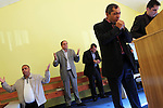 A pastor is leading a prayer during a Sunday service at the Pentecostal church in Barbulesti, Romania. 15 years ago, the population of Barbulesti, a village situated in the south of Romania and inhabited mostly by ROMa people, started to convert to the Pentecostal Church. Believers say that conversion led to a decrease in crime in the area, although official statistics do not confirm it.