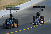 Jul. 30, 2011; Sonoma, CA, USA; NHRA top fuel dragster driver Steve Chrisman (right) crosses the centerline behind Troy Buff during qualifying for the Fram Autolite Nationals at Infineon Raceway. Mandatory Credit: Mark J. Rebilas-