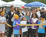 Ribbon Cutting - Deborah Koenigsberger - Hearts of Gold 7th Annual Run/Walk for Kids with proceeds from this fun family event will change the futures of homeless mothers and their children on June 3, 2017 at Pier 84 Hudson Parks, New York City, New York. It supports Hearts of Gold Annual Back to School Programs. (Photo by Sue Coflin/Max Photos)