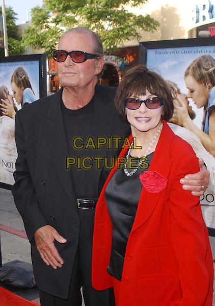 "JAMES GARNER & WIFE.Attend New Line Cinema's World Premiere of ""The Notebook"" held at The Mann Village Theatre in Westwood, California .June 21,2004.half length, half-length, sunglasses, shades, red, black jacket.www.capitalpictures.com.sales@capitalpictures.com.©Capital Pictures"