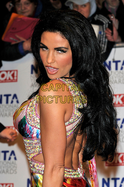 JORDAN - KATIE PRICE .The 15th National Television Awards held at the O2 Arena, London, England..January 20th, 2010.NTA NTAs half length white pink blue green orange cleavage dress beaded diamante jewel encrusted multi-coloured backless looking over shoulder mouth open.CAP/PL.©Phil Loftus/Capital Pictures.