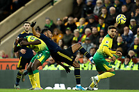 1st December 2019; Carrow Road, Norwich, Norfolk, England, English Premier League Football, Norwich versus Arsenal; Pierre-Emerick Aubameyang of Arsenal competes for the ball with Ibrahim Amadou of Norwich City - Strictly Editorial Use Only. No use with unauthorized audio, video, data, fixture lists, club/league logos or 'live' services. Online in-match use limited to 120 images, no video emulation. No use in betting, games or single club/league/player publications