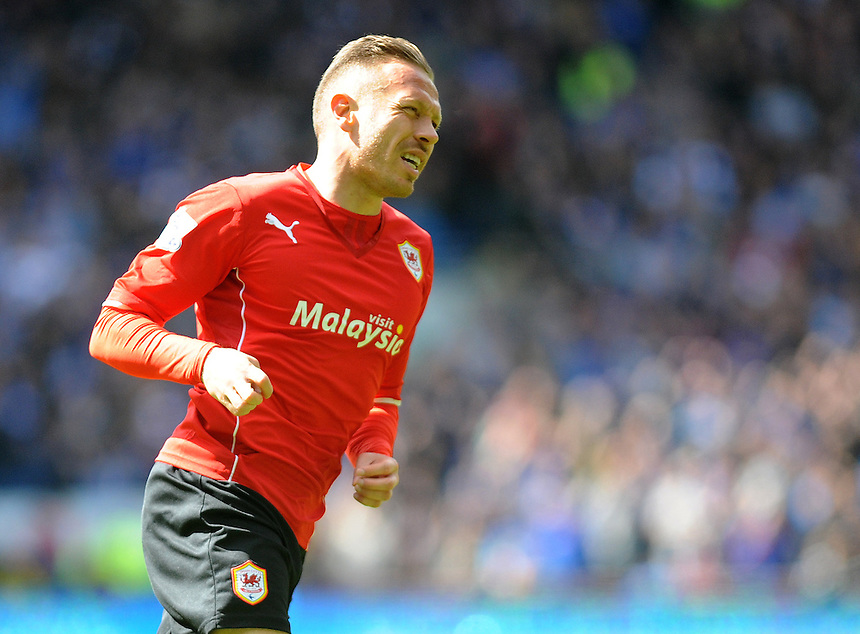 Cardiff City's Craig Bellamy celebrates scoring the opening goal <br /> <br /> Photographer Ashley Crowden/CameraSport<br /> <br /> Football - Barclays Premiership - Cardiff City v Chelsea - Sunday 11th May 2014 - Cardifff City Stadium - Cardiff<br /> <br /> &copy; CameraSport - 43 Linden Ave. Countesthorpe. Leicester. England. LE8 5PG - Tel: +44 (0) 116 277 4147 - admin@camerasport.com - www.camerasport.com