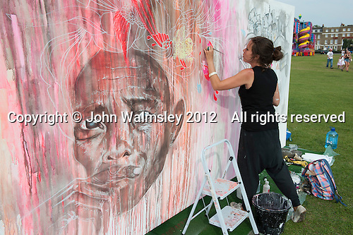 """Joanna Layla (www.joannalayla.com), artist, taking part in """"Showtime"""", part of the London 2012 Festival of Arts to celebrate the London Olympics.  A family fun spectacle including dance, painting, music, acrobatics and some large mobile dynosaurs walking amongst the crowd.  On Blackheath Common, Saturday August 4th and funded by the Mayor of London and Arts Council England."""