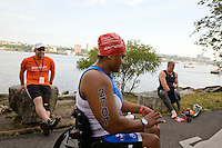 Minda gets ready to compete in the Aquaphor New York City Triathlon while her boyfriend and handler Shawn looks on in New York on July 8, 2012.