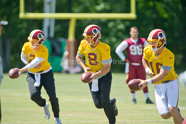 Washington Redskins quarterbacks Nate Sudfeld (2), Kirk Cousins (8) and Colt McCoy (16) practice their hand-offs as they participate in the Veteran Minicamp at Redskins Park in Ashburn, Virginia on Tuesday, June 14, 2016.<br /> Credit: Ron Sachs / CNP/MediaPunch ***FOR EDITORIAL USE ONLY***