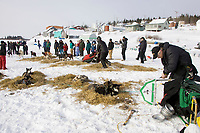 Jeff King changes sled runners as Lance Mackey leaves the White Mountain checkpoint  Tuesday afternoon during Iditarod 2008