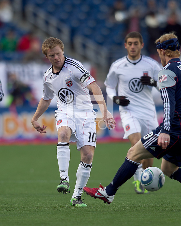 DC United midfielder Dax McCarty (10) passes the ball as New England Revolution midfielder Pat Phelan (28) closes. In a Major League Soccer (MLS) match, the New England Revolution defeated DC United, 2-1, at Gillette Stadium on March 26, 2011.