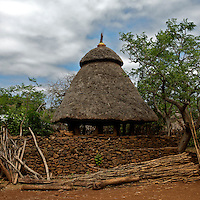 """The main hut of the village of Dokoto, near Konso, in Southern Ethiopia on August 31, 2010...Trachoma (Ancient Greek: """"rough eye"""") is an infectious eye disease, and the leading cause of the world's infectious blindness. Globally, 84 million people suffer from active infection and nearly 8 million people are visually impaired as a result of this disease. Globally this disease results in considerable disability..Ethiopia carries the largest burden of trachoma infection--30%--in Africa.   .1.3 million Ethiopians (15 years and older) have trichiasis, the advanced stage of trachoma, and need immediate surgery. .Of children aged 1-9 years, over 9 million--40%--have an active trachoma infection;  in some Ethiopian districts, more than 80% of children have active trachoma. .( Source: WHO 2008 ).."""
