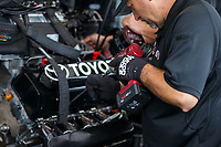 Feb 10, 2018; Pomona, CA, USA; Detailed view as a crew member works on the engine of NHRA top fuel driver Antron Brown during qualifying for the Winternationals at Auto Club Raceway at Pomona. Mandatory Credit: Mark J. Rebilas-USA TODAY Sports