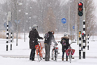 People with Bicycle at Snow in Netherlands