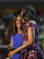 September 6, 2012  (Charlotte, North Carolina) First lady Michelle Obama and daughter Sasha on the last night of the 2012 Democratic National Convention In Charlotte.   (Photo by Don Baxter/Media Images International)