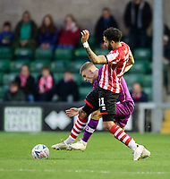 Lincoln City's Bruno Andrade vies for possession with Carlisle United's Regan Slater<br /> <br /> Photographer Chris Vaughan/CameraSport<br /> <br /> The Emirates FA Cup Second Round - Lincoln City v Carlisle United - Saturday 1st December 2018 - Sincil Bank - Lincoln<br />  <br /> World Copyright © 2018 CameraSport. All rights reserved. 43 Linden Ave. Countesthorpe. Leicester. England. LE8 5PG - Tel: +44 (0) 116 277 4147 - admin@camerasport.com - www.camerasport.com