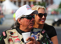 Aug. 18, 2013; Brainerd, MN, USA: NHRA funny car driver John Force (left) with daughter Brittany Force during the Lucas Oil Nationals at Brainerd International Raceway. Mandatory Credit: Mark J. Rebilas-