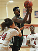 Mike McDermott #5 of Harborfields drives to the net during a non-league varsity boys basketball game against host Glen Cove High School on Tuesday, Dec. 5, 2017. Harborfields won by a score of 65-57.