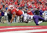 MADISON, WI - SEPTEMBER 9: Tight end Andy Crooks #43 of the Wisconsin Badgers dives into the endzone as Kevin Almlie #25 of the Western Illinois Leathernecks tries to make the tackle at Camp Randall Stadium on September 9, 2006 in Madison, Wisconsin. The Badgers beat the Leathernecks 34-10. (Photo by David Stluka)