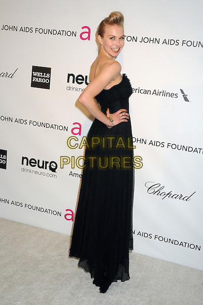 Penelope Mitchell.21st Annual Elton John Academy Awards Viewing Party held at West Hollywood Park, West Hollywood, California, USA..February 24th, 2013.oscars full length black strapless dress waistband hand on hip side.CAP/ADM/BP.©Byron Purvis/AdMedia/Capital Pictures.