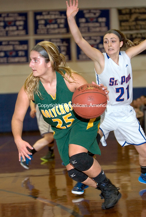BRISTOL CT. 07 February 2015-020715SV08-#25 Casey DiZinno of Holy Cross High drives to the hoop as #21 Lizzy Cretella of St. Paul Catholic defends during basketball action in Bristol Saturday.<br /> Steven Valenti Republican-American