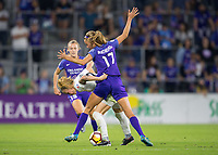 Orlando, FL - Saturday March 24, 2018: Utah Royals Gunnhildur Jonsdottir (23) tries to hold off Orlando Pride midfielder Dani Weatherholt (17) during a regular season National Women's Soccer League (NWSL) match between the Orlando Pride and the Utah Royals FC at Orlando City Stadium. The game ended in a 1-1 draw.