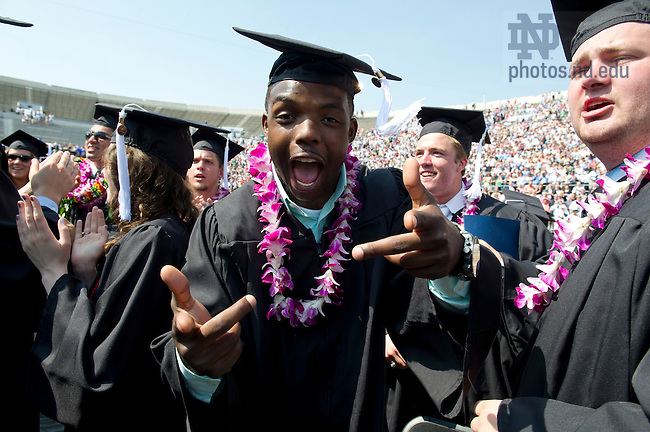 May 19, 2013;  Theo Riddick celebrats after the 2013 Commencement ceremony in Notre Dame Stadium. Photo by Barbara Johnston/University of Notre Dame