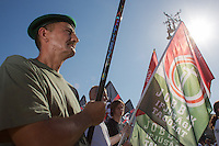 Members of the unauthorized far-right Hungarian National Guard attend a gathering to commemorate the anniversary when their organization was formed in protest against the government in Budapest, Hungary on August 25, 2012. ATTILA VOLGYI
