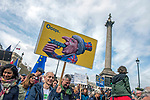 "Protesters with Theresa May placard in front of Nelson's Column during the ""Put it to the People"" rally whch made it's way through central London today. Demonstrators from across the country gathered to call for a second referendum on Brexit and to march through the UK capital finishing with speeches in Parliament Square opposite the Houses of Parliament in Westminster."