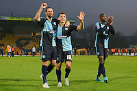 Wycombe Wanderers captain Paul Hayes, Matt Bloomfield and Aaron Pierre salute their supporters after the Sky Bet League 2 match between Mansfield Town and Wycombe Wanderers at the One Call Stadium, Mansfield, England on 31 October 2015. Photo by Garry Griffiths.
