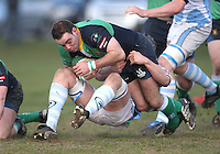 Ballynahinch centre Jonny Cullen is tackled by Garryowen number 8 Dave Sherry during the AIB Cup semi-final at Ballymacarn Park, Ballynahinch. Mandatory Credit - John Dickson