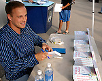 "30 June 2007: Former Vermont Expos pitcher Kenny Beck talks with fans and signs copies of his book ""What Day Is Today?"" at a game between the Vermont Lake Monsters and the Lowell Spinners at Historic Centennial Field in Burlington, Vermont. Beck m1aintained a journal during his minor league stint in 2002, and recounts the  experiences of a minor league ballplayer trying to move up to the majors. Kenny Beck, currently works as a television news anchor in Salisbury, MD. ..Mandatory Photo Credit: Ed Wolfstein Photo"