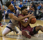 Nevada forward Jordan Brown, left,  and Little Rock forward  Kamani Johnson fight for a lose ball in the first half of an NCAA college basketball game in Reno, Nev., Friday, Nov. 16, 2018. (AP Photo/Tom R. Smedes)
