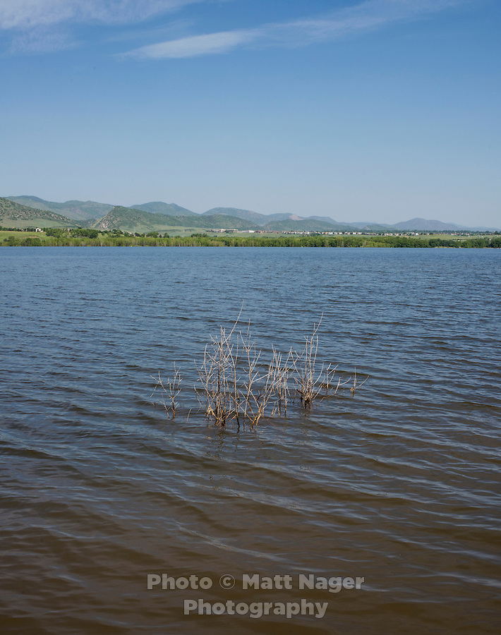Chatfield Reservoir, in Littleton, Colorado, Monday, June 23, 2015. The reservoir and dam were built by the United States Army Corps of Engineers as a response to a flooding of the South Platte River in 1965. In addition to its primary purpose of flood control, it serves as one of many water supply reservoirs for the city of Denver, Colorado. <br /> <br /> <br /> Photo by Matt Nager
