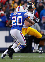 ORCHARD PARK, NY - NOVEMBER 28:  Heath Miller #83 of the Pittsburgh Steelers is tackled by Donte Whitner #20 of the Buffalo Bills during the game on November 28, 2010 at Ralph Wilson Stadium in Orchard Park, New York.  (Photo by Jared Wickerham/Getty Images)