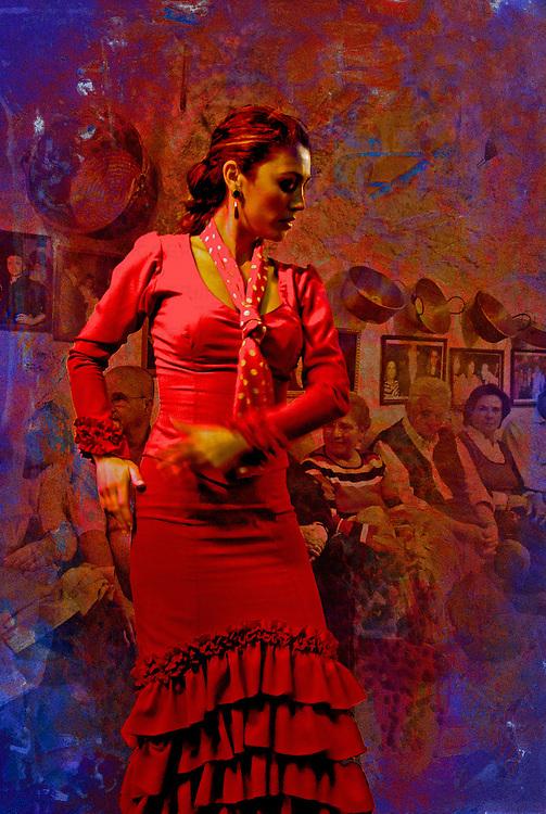 A woman dances passionately to Flamenco music i Spain.