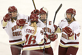 Danielle Welch (BC - 17), Kelli Stack (BC - 16), Katelyn Kurth (BC - 14) and Alison Szlosek (BC - 8) celebrate Stack's goal. - The Boston College Eagles defeated the visiting Northeastern University Huskies 2-1 on Sunday, January 30, 2011, at Conte Forum in Chestnut Hill, Massachusetts.