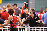 Central Missouri red-shirt sophomore Erin Alewine gets a celebratory high five from Coach Elle Cruikshank after clearing 5-8 in the high jump at the 2012 MIAA Indoor Track & Field Championships at Missouri Southern in Joplin, February 26. Alewine finished second to teammate Lindsay Lettow who also cleared 5-8.